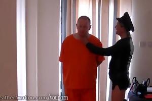 dom leather clad femdom-goddess spanks prisoner