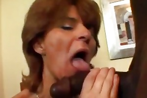 aged wench in fishnets takes darksome rod