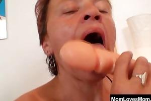 hirsute grandma and freaky madame mad fake penis
