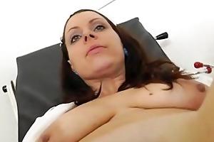 speculum in a taut madam medic vagina