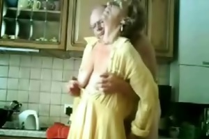 mamma and dad having fun in the kitchen. stolen