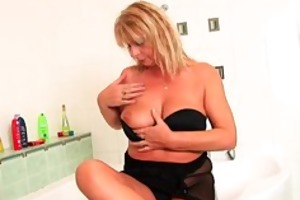 chubby grandma with hanging large melons rubs her