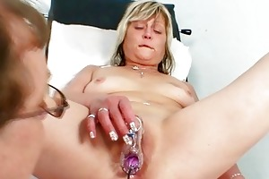 horny golden-haired granny toys her pussy at gyno