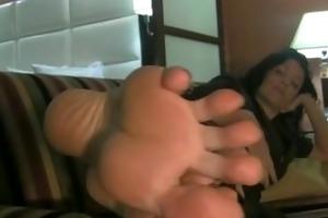 big feet on sofa