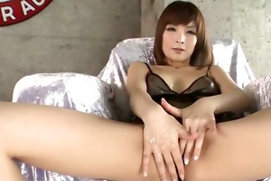 riona suzune is oiled up whilst she is plays with
