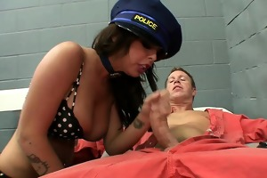 sexy lady cop punishing prisoner with cookie