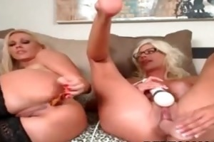 blond lesbo playing in ottoman with sextoy