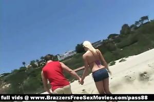 hot pair walking down the beach